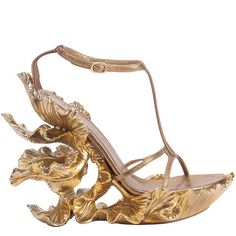 i would never wear them unless i were some greek goddess but other than that they are pretty freakin cool. gold iris platform sandals by alexander mcqueen