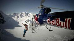 Travis Rice snowboarding out of a helicopter