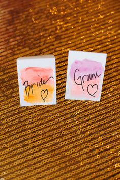 sunset inspired watercolor place cards // photo by Sarah Joelle Photography // View more: http://ruffledblog.com/colorado-boho-wedding/