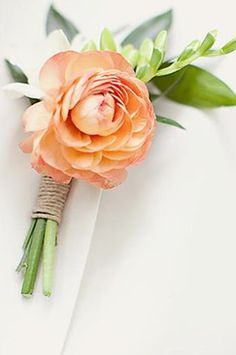 Lapel Pin in peach and white. Ranunculus and freesia with Jute twine