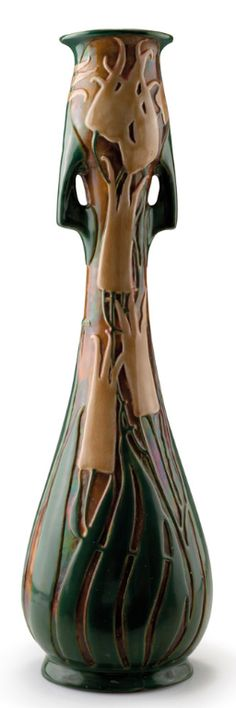 Vilmos Zsolnay, Pécs. Large vase, circa 1900.  Earthenware, eosin glaze in green and vanilla yellow on brown, stylised flowers, inside matt green. Marked: ZSOLNAY PECS (seal), remains of a paper label.H. 49.5 cm.  |  SOLD 3.700 EUR, 2011