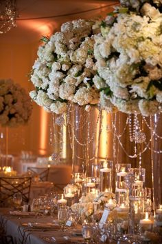 Dangling details, tall vases and candles make this centerpiece perfect! #LaFete
