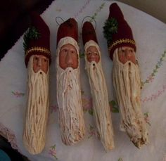 I made these primitive Santas from tree branches I found in the woods. Some  of them have hats made of fleece others the hats were painted on.  I used a build up medium to create their beards and their.  noses were made from air dryed clay.  www.picturetrail.com/sheepscotriverprimitives  <3