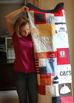 I recently had a quilt made out of baby clothes for each of my sons.  I have a hard time getting rid of things with sentimental valu...