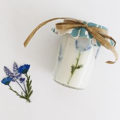 Beautiful soy candle with dry flowers! 🦋
