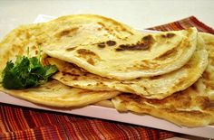 Chapattis - 2 1/2 cups fine whole wheat flour; 2 cups water (or enough to make a soft dough); pinch of salt. Mix flour & salt, slowly add water making a soft dough.  Knead for 5 min.  Cover with wet cloth & chill for an hour.  Heat a cast iron skillet over med. until very hot.  Roll out 1/2 handful of dough into flat round and place in pan, cooking for 1 min each side.  Once turned, press gently w/towel, until brown. Repeat until dough is all used up!