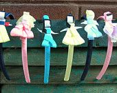 Princess Ribbon Sculpture Headband and Clip. $6.00, via Etsy.