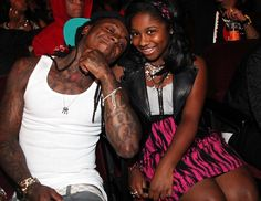 Lil Wayne and his daughter Reginae Carter attend the 2011 BET Awards.
