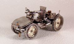 Dmitriy Khristenko, a USA-based Ukrainian-born artist, creates miniatures, all built entirely from recycled wristwatch parts.