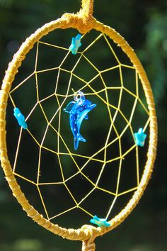Dolphin Dreams  Dream Catcher by raventalker on Etsy,   A Dolphin totem can show you how to enter the waters of life and then with breath and sound call forth what you most need or desire.