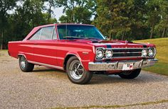 "1967 Plymouth Belvedere GTX  If this was blue, with hood locks and  ""Plymouth"" decals on the fenders, it would be just like the one we had when we were first married."