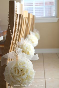 8 inch ivory rose wedding pomanders with ivory pearl loop and organza bows. All 8 inch pomanders are $15 each. custom orders! www.psalm117.etsy.com