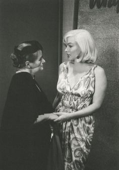 """Marilyn Monroe with Paula Strasberg during the dinner celebrating the beginning of filming """"The Misfits.""""    [July 24, 1960 by Inge Morath]"""