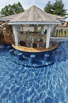 Contemporary Swimming Pool with Fence, Gazebo, Pathway, Infinity pool, Custom Pool Built-in, exterior stone floors