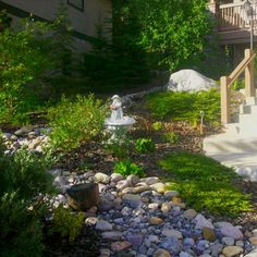 This design shows how a steeply sloping front yard can be tamed without using retaining walls.