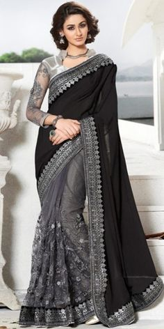 Teriffic Black And Grey Net Saree With Blouse.