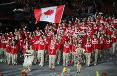 Team Canada !!!  Canada's flag bearer Simon Whitfield  holds the national flag as he leads the contingent in the athletes parade during the opening ceremony of the London 2012 Olympic Games