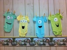 Monster baby shower, felt sewn on to make monster faces....how cute!