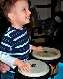 Music & Development: Musical ways to engage developmentally disabled children - This article explains what Music Therapy is, why it's an important part of any special needs child's arsenal of services and how parents can enhance their child's life at home by including more musical activities. Music can be especially motivating for children who are visually impaired!