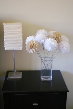 Set of 12 stemmed tissue pom poms ready to open by melodywei, $30.00