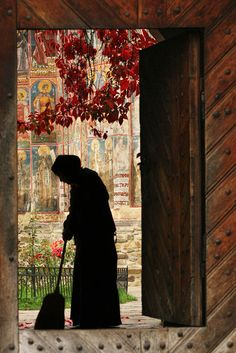 A nun tidies up inside the Moldovita Monastery Cosmin Danila (Brasov, Romania) Photographed September Bucovina, Romania --> LOVE LOVE LOVE this photo! Russian Orthodox, People Of The World, Kirchen, Around The Worlds, Places, Image, Beautiful, Diy Christmas, Christmas Ornaments
