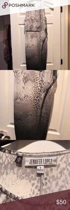 Jennifer Lopez dress Brand new with tags attached Never been worn. Size 4. Snake skin dress with zippers. Stretchy material. Jennifer Lopez Dresses Midi