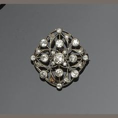 The openwork lozenge-shaped panel of foliate design, millegrain collet set with graduated old brilliant and single-cut diamonds, to later brooch fitting, length 2.5cm.