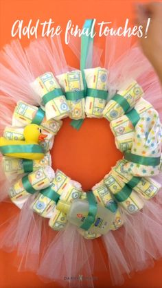 Turn Diapers into a Wreath for an adorable baby shower decoration or gift