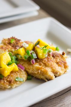 Coconut Crusted Chicken With Mango Salsa - Lovely Little Kitchen (Can be made paleo with coconut flour and coconut milk)