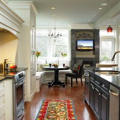knock the bar down, move the stove against the wall, knock down the island build a newer one with mor storage and futher down so that way you can have just a small banquet area and get more use out of the dinning room