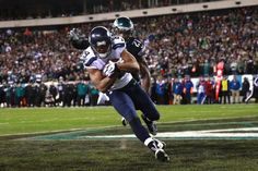 Seattle Seahawks' Doug Baldwin (89) pulls in a touchdown against Philadelphia Eagles' Malcolm Jenkins (27) during the second half of an NFL football game, Sunday, Dec. 7, 2014, in Philadelphia. (AP Photo/Matt Rourke) Seattle Seahawks vs. Philadelphia Eagles - Photos - December 07, 2014 - ESPN
