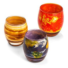 Drink your primordial water from this set of 10 glasses. The glasses for the 8 planets are identical in size. The sun's a little bigger than the rest, and Pluto's a little smaller than the rest.