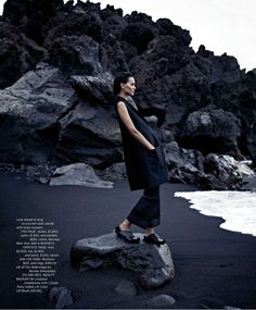 Liya Kebede by Nathaniel Goldberg for Harpers Bazaar US March 2013 -- minimal black outfit on black rocks, black sand