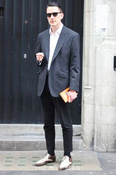 Men's street style | Urban Sass - Keep it cool with an oversized charcoal blazer over a white t-shirt and a pair of formal black trousers. Add some edge to the look with a distinct pair of brogues and some retro shades. | Shop the look at The Idle Man