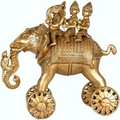 Ganesha riding an elephant with wheels.