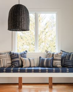 Pile on the pillows to create a relaxed seating area. We used Souk Indigo fabric as the bench cover and layered Coastal Block Stripe Mariner Stripe Indigo Coastal Stripe Indigo and Coastal Stripe x pillows. Pillow Drawing, Bench Covers, Nautical Design, Cozy Nook, Patchwork Designs, Inspired Homes, Table Linens, Decorative Pillows, Home Goods
