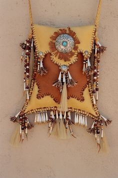 Swallow Tail Bag by Carole Hook. Deerskin, antique beads, sterling silver embellishments.