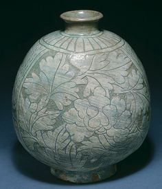 Joseon Buncheong Ware: Between Celadon and Porcelain: Flask-Shaped Bottle, Joseon dynasty (1392–1910), late 15th century  Korea  Stoneware with sgraffito decoration of flowers under buncheong glaze