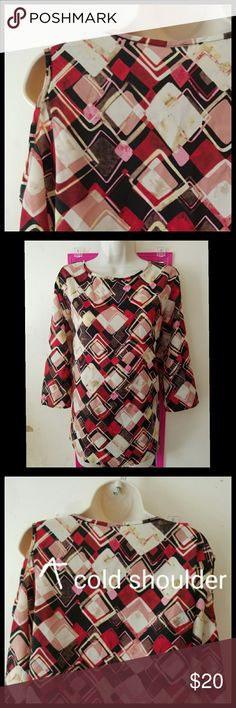 Modcloth Teenplo Geo Cold Shoulder Top Cold shoulder blouse from Teenplo (sold at Nasty Gal). Mauve, cream, red, and black geometric print. Three quarter sleeves. 100% polyester. No stretch. Size large. Should fit an 8-10. Bust 42 inches. Length 26.5 inches. EUC. Looks brand new! No flaws or stains. Modcloth Tops Blouses