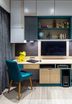 A compact home office with ample storage in the bedroom of an apartment. Design: Studio Osmosis.