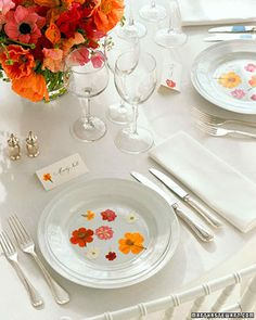 For a reception, brighten plain dinnerware with a sprinkling of cheerful blooms that coordinate beautifully with your centerpieces.