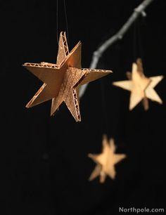 Easy DIY cardboard star ornaments. Paint them silver or gold!