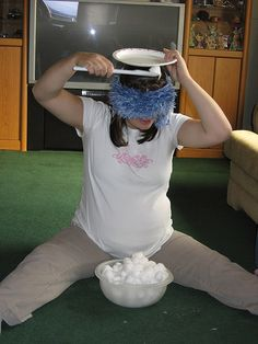How many cotton balls can you put in the plate with wooden spoon while blindfolded and timed.