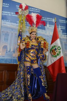 Miss Universe Peru Nicole Faveron: Nicole is like an Inca Queen in this royal blue, gold with red and white Peruvian flag colors costume
