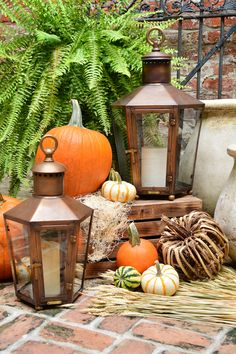 Give your home a cozy look this fall - Bevolo Rault Pool House Lanterns with fall decor. #fall #lanterns #decor #pumpkins #decorating