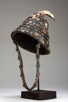 Africa | Hat from the Lega people of DR Congo | Basketry bonnet decorated with buttons and a wild boar tusk.