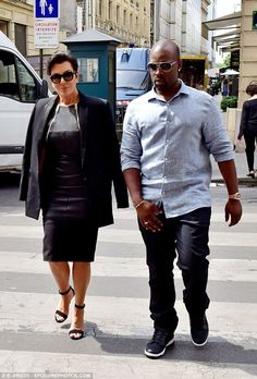 Super chic: Kris added a pair of strappy heels and draped a classic blazer over her should...