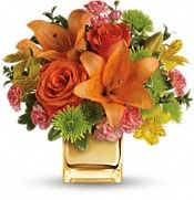 Teleflora's Tropical Punch Bouquet of flowers in a golden mirror cube vase