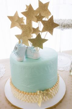 Cute blue and gold baby shower cake
