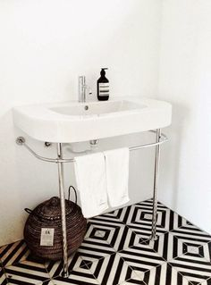 I love black and white tiles  Black White Chevron Floor Bathroom/Remodelista